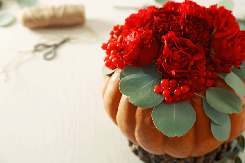 Jazz up your assisted living facility space with fun DIY projects like this pumpkin floral arrangement/planter.